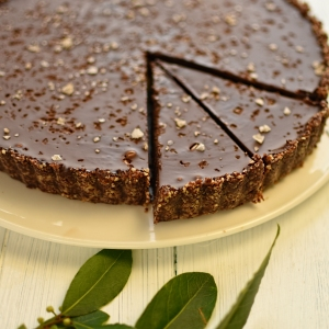 sliced chocolate and salt caramel tart